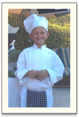 Little boy dressed as a chef